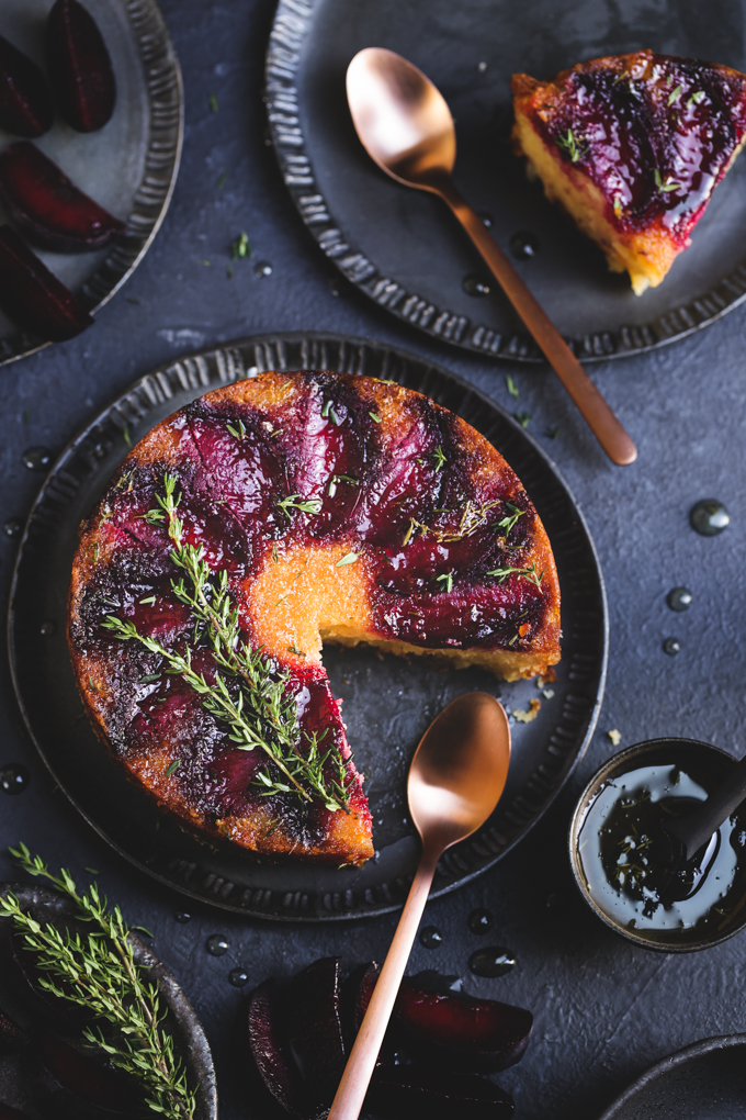 This tiny gluten free plum cake is laced with tangy lemon thyme syrup, and showcases jewelled plum tones in a delightful small batch autumn treat.